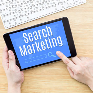 Search Engine Marketing written on Tablet